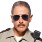 Deputy James Garcia played by Carlos Alazraqui