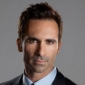 Agent Victor Machado played by Nestor Carbonell