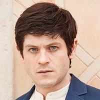 Adam Clios played by Iwan Rheon