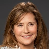 Angela Rizzoli played by Lorraine Bracco