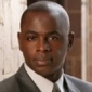 Quizmaster Albert played by Alimi Ballard