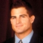 Travis Peterson / Nick Corelli played by George Eads