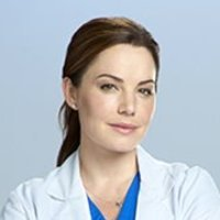 Dr. Alex Reid played by Erica Durance