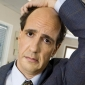 Ted Buckland played by Sam Lloyd