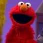 Elmo played by Kevin Clash