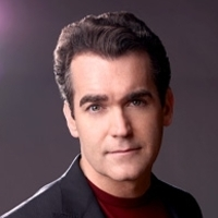 Frank played by Brian d'Arcy James