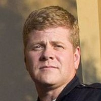 John Cooper played by Michael Cudlitz