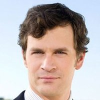 Russell played by Tom Everett Scott