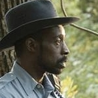 Officer Powell played by Rob Morgan
