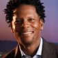 Simon Stiles played by D.L. Hughley