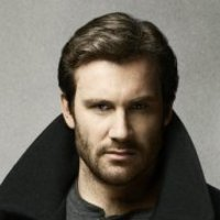 Bryan Millsplayed by Clive Standen