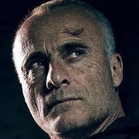 Father Ruskin played by Timothy V. Murphy