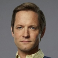Tom Bradshawplayed by Matt Letscher