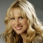 Holly Ellenbogenplayed by Lucy Punch