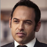 Andrew Palmerplayed by Shaun Majumder