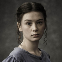 Flora played by Eloise Smyth