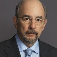 Aaron Glassman played by Richard Schiff