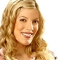Molly, the Dog Walker played by Tori Spelling