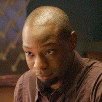 Carter Howard played by Nelsan Ellis