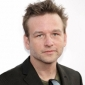 Angus Partridge played by Dallas Roberts