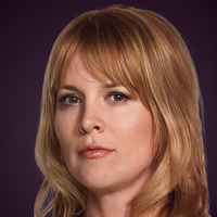 Tina Kennard played by Laurel Holloman
