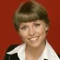Cruise Director Julie McCoy played by Lauren Tewes