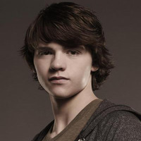 Peter Moore played by Joel Courtney Image