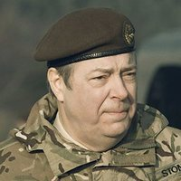 Adrian Stone played by Roger Allam