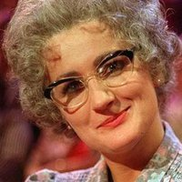 Mrs. Mertonplayed by Caroline Aherne