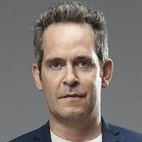 Major Corcoran played by Tom Hollander