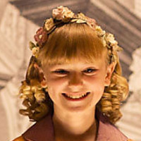 Flora played by Edie Whitehead