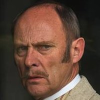 Lord Glendenning played by Patrick Malahide