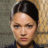 Officer Tina Hanlon played by Paula Garcés