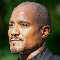 Father Gabrielle Stokes played by Seth Gilliam