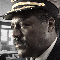 Commissioner Ervin H. Burrell played by Frankie Faison