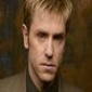 Phil played by Ron Eldard Image