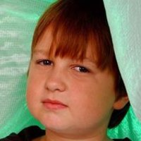 Jake Harper played by Angus T. Jones
