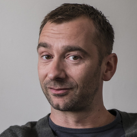 Simon played by Charlie Condou