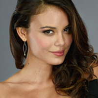 Grace played by Nathalie Kelley