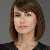 Quinn King played by Constance Zimmer