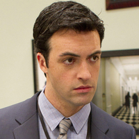 Dan Egan played by Reid Scott