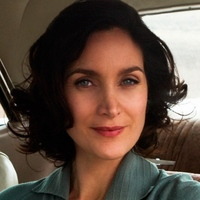 Katherine O'Connell played by Carrie-Anne Moss