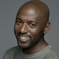 Conrad Shepard played by Romany Malco