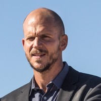 Karl Strand played by Gustaf Skarsgård