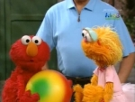 36x19 - Elmo and Zoe Claim a Ball