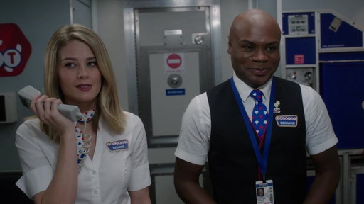 Season 1, Episode #9 Ronnie Makes an Announcement That the Flight Is Overbooked Screenshot