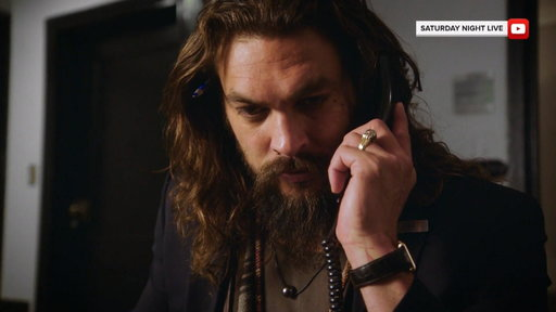 S0E0 Jason Momoa is an action hero-turned-NBC page in 'SNL' promo